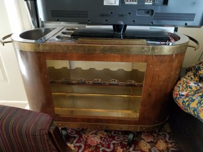 Vintage mid century modern wood & brass oval portable bar with glass rack