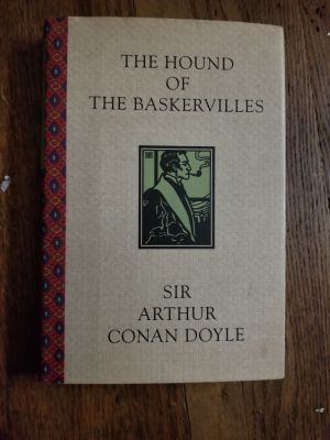 Sherlock Holmes Hound of the Baskervilles hardcover book.