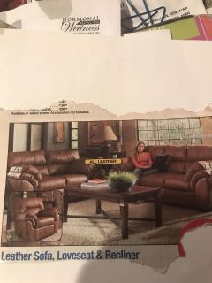 Living room set-leather by Ashley. In excellent condition:to large for downsizing house.