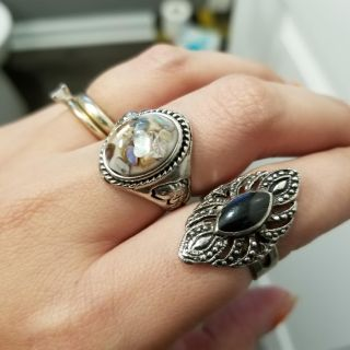 Black and silver colored adjustable ring