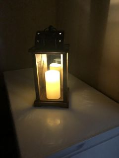 Beautiful lantern with candle. 15 inches tall.