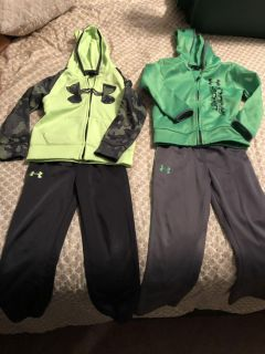 Two Under Armour track suits size 4