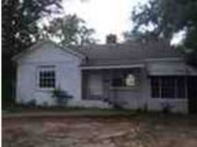 Completely Remodeled All Brick Three BR One BA Home With Screen