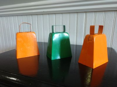 Cow bells 2 orange 1 green.