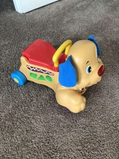 Fisher Price ride-on and push toy.