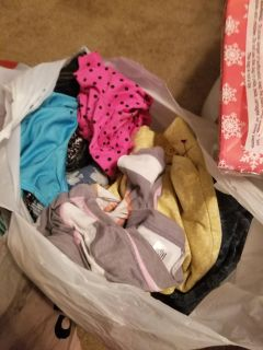 3 bags full of female clothes