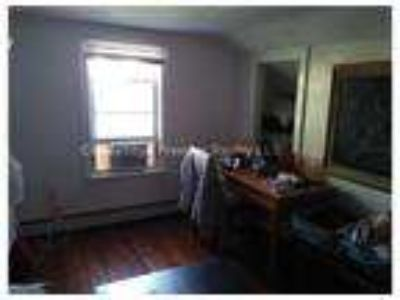 Two BR/One BA, wood floors, in-unit laundry, eat-in-