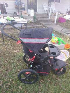 grey black red jogging stroller