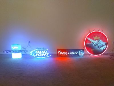 Bud and coors neon signs