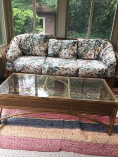 Wicker/cane sofa and glass top coffee table