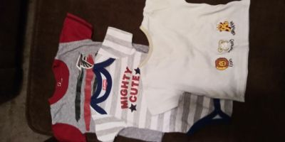 3 to 6 month bundle. Two onesies and a shirt.