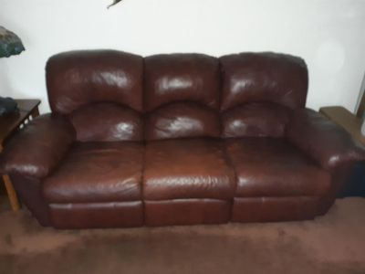 Overstuffed leather sofa with recliner at each end.