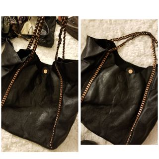 Black purse with gold chain strap