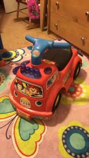 Fisher price fire truck ride along