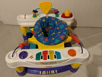 Piano musical play exersaucer