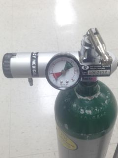 OXYGEN TANK WITH REGULATOR AND TWO WHEELED CARRIER