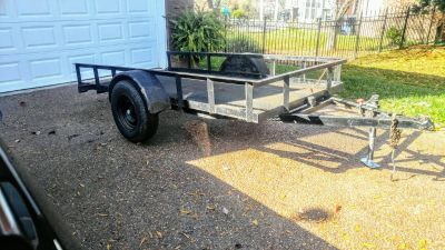 5.6' by 10' utility trailer with tilt