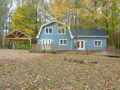 A picturesque setting on 2 acres in sought after Fawn Lake Estates.