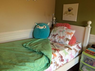 Adorable white twin bed. Mattress included.
