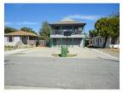 2nd floor unit: UPDATED DUPLEX- Four BR, Two BA, LAMINATE WITH CERAMIC TILE