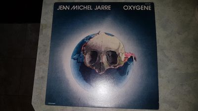 "Jean-Michel Jarre ""Oxygene"" vinyl LP record. The sleeve is worn, the record itself in very good condition. $4"