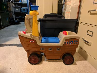 Ride on pirate ship. Has a button to make noises. Great condition!
