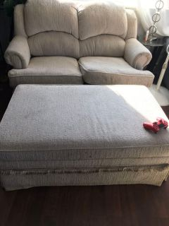 Love seat with a pull out bed and ottoman
