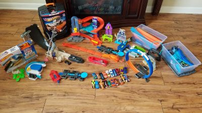 Huge lot of hot wheels, tracks, and add ons
