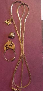 Monet brand necklace, charm holder and two charms