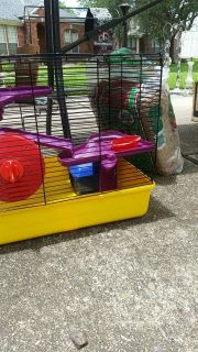 Hamster cage with bedding