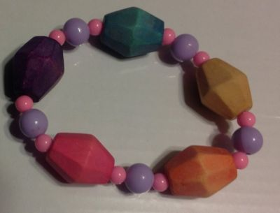 Cute bracelet with wooden and plastic beads