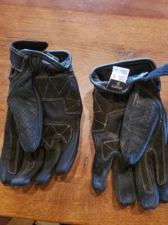 Gloves underneath showing size tag
