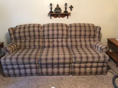 Brown couch with 2 recliners and wingback chair to match