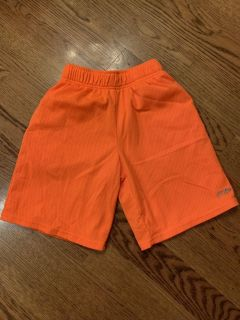 Champion bright orange athletic shorts, excellent condition, size med 8/10