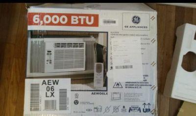 G.E. 6000 BTU AIR CONDITIONER WITH REMOTE IN THE BOX $60