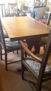 Oak mission style table with six chairs