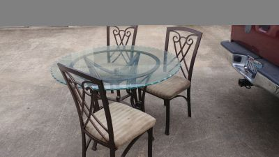 Table with 3 chairs. Glass top on metal,heavy duty frame