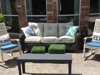 Heavy all weather wicker sofa and cushions (accent pillows excluded). Sofa needs spray paint touch up and a little TLC.
