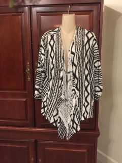 15.00 Chico's size 3 (like a 1X) gorgeous cardigan with 3/4 sleeves. You'll love it!