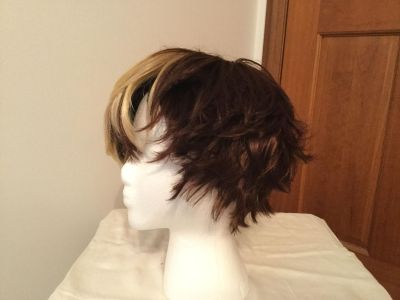 Wig adjustable. New. Stand not included. Natural.