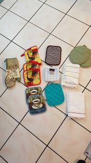 Assorted kitchen Rags hand towels and potholders