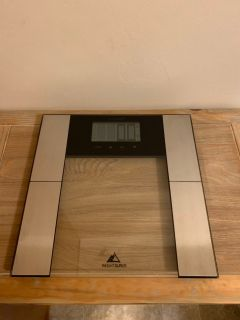 Weight Gurus scale. Connects to phone to track weight.