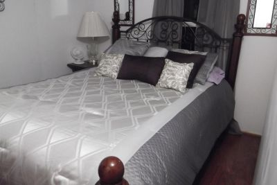 Cherry wood and wrought queen size bed