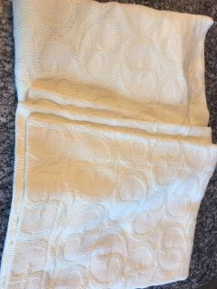 Pair of light yellow pillow shams