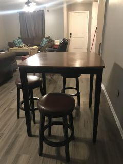 Tall table with 4 bar stools.