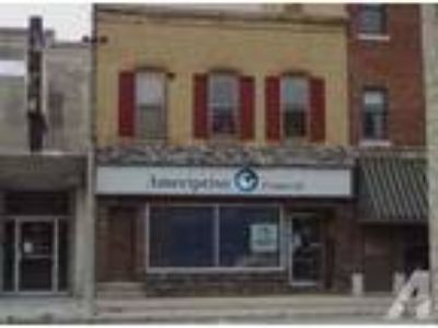 Income Opportunity! Main level Office Space w/ Apartments. on Up