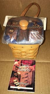 1999 Longaberger Chives Booking Basket Combo. Includes: basket, protector, & lid. Lid is from Heart of Dresden new still in the package.