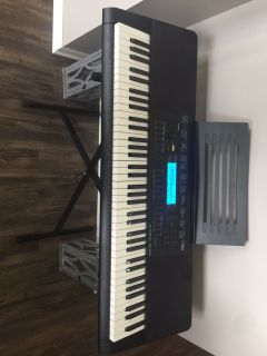 Casio electric piano and stand.