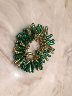 Green and gold bracelet $1