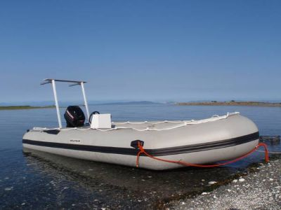 18ft inflatable boat with 60hp motor and trailer